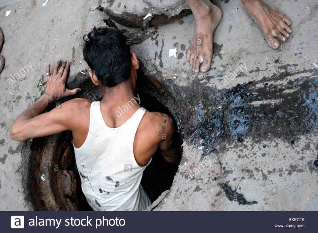 a-man-cleans-sewers-delhi-this-work-is-traditionally-done-by-dalits-bxect6
